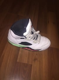 Unpaired white, green, and pink air jordan 5