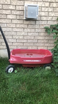 Red and black radio flyer pull wagon