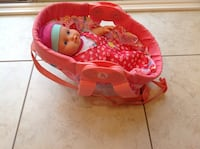 Dressed up doll with Seat,the seat has a  straps to hang it on the baby back Hamilton, L8V 4K6