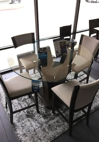 Counter height glass table with 4 chairs