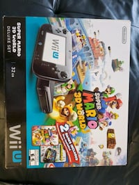 Boxed Nintendo Wii U with controllers
