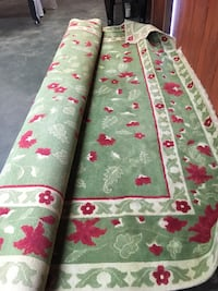 green and red floral print area rug