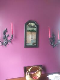 Mirror and candle holders with candles