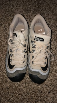 pair of gray-and-black Nike basketball shoes