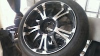 silver car wheel and tire 20 inch Chevy Chase