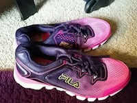 pair of red-and-purple Nike running shoes Greensboro