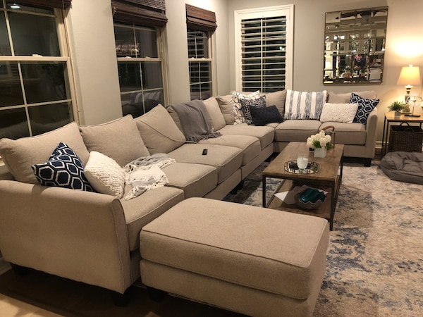 Used Gray fabric sectional sofa with throw pillows. Gel cushions ...
