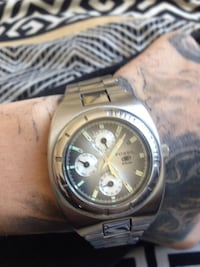 Round silver-colored chronograph watch with link bracelet Winnipeg, R2Y 1Z2