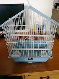 white and blue metal birdcage. Toronto, M3C 1B5