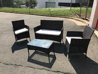 four black wooden framed gray padded chairs Arlington, 22202