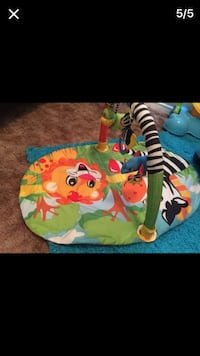yellow, green, black and white multi colored animal print activity mat Apple Valley, 92308