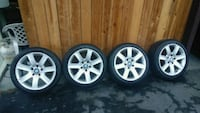silver 7-spoke vehicle wheel and tire set Monterey County, 95076