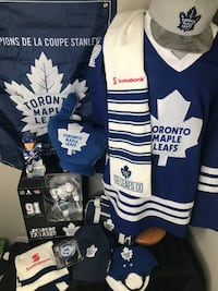 The Ultimate Toronto Maple Leaf Fan Family Pack    Many items for the Ultimate Leaf fan!  Toronto Maple Leaf Jersey Reebok NHL L/XL Scarf 1- Go Leafs Go TML Scotia Bank  Scarf 2 - 100 Years TML Scotia Bank Baby Helmet TML Style Cap Hat Trick Miniature Hoc Toronto