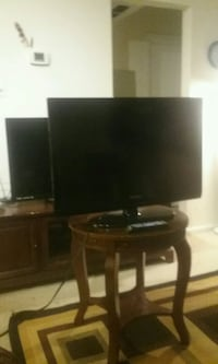 black flat screen TV with black wooden TV stand Alexandria, 22306