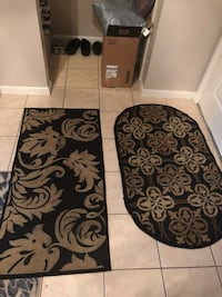 two oval and rectangular brown floral door rugs