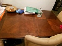 Very nice dining room table with two chairs