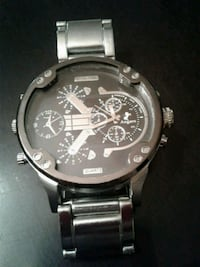 round silver-colored chronograph watch with link bracelet 807 km