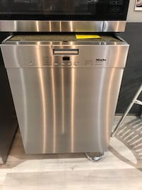 stainless steel and black Arcelik dishwasher null