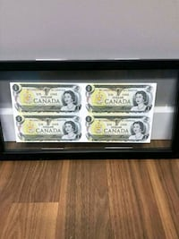 Uncut $1 Bank notes in glass frame Calgary, T3K 1B4