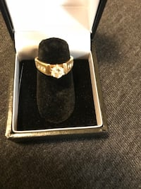 gold-colored ring with box Rockville, 20852