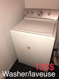 White top-load clothes washer 787 km