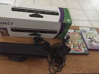 Black Xbox 360 kinect with box and two game cases