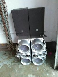 two black multimedia speakers and gray shelf stereo