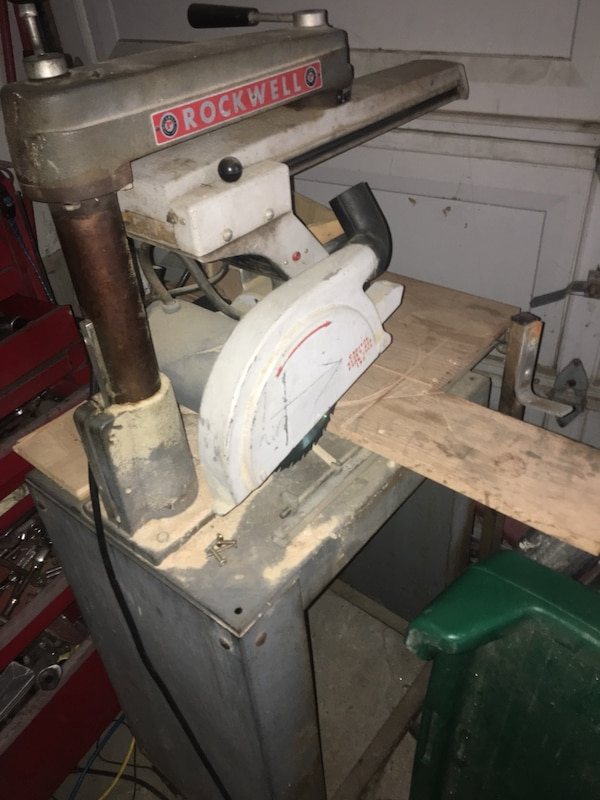 Gray and red rockwell radial saw