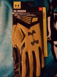 pair of blue-and-yellow Under Armour hand gloves