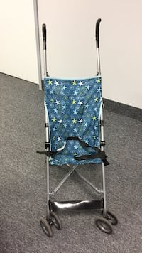 baby's blue, grey, and black star print umbrella stroller