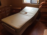 brown wooden bed frame and white mattress New Port Richey, 34654
