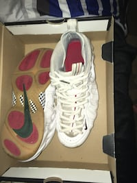 pair of white-and-red Nike sneakers Olympia, 98503