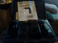 black Sony PS3 game console with game cases Davis Junction, 61020