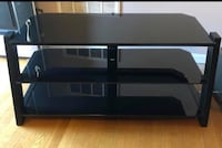 Black  glass tv stand. Solid. Will have to pick up. For 50.00 paid 245.00 for it two years ago. In West Knoxville 37923 Knoxville, 37909