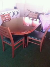 round brown wooden table with four chairs dining s Hagerstown, 21742