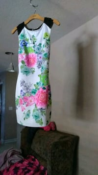 white, pink, and green floral textile