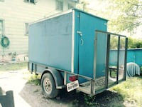 blue and grey enclosed trailer