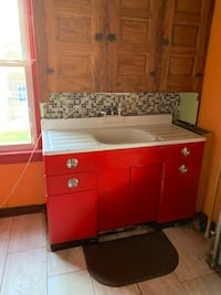 Vintage sink with red metal cabinet