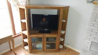 flat screen television with brown wooden TV hutch Baltimore, 21234