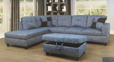 Blue linen sectional couch and ottoman