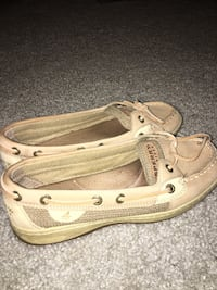 women's pair of beige Sperry boat shoes