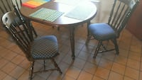 Kitchen table with 2 extensions and 6 chairs
