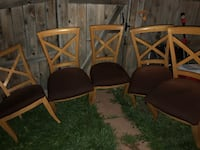 four brown wooden framed black padded chairs Aurora, 80011