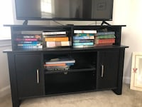 black wooden TV stand with flat screen television Raleigh, 27607