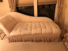 Upholstered chaise lounge.