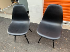 Two black on black dining chairs