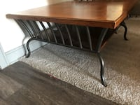 brown wooden table with black metal base Fort Worth, 76244