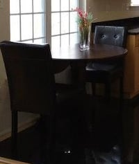 Wood round extending dining table.  Cash only. Greenbelt, 20770