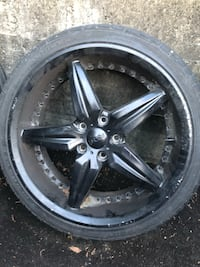 Black 5-spoke car wheel with tire Surrey, V3V 7X6