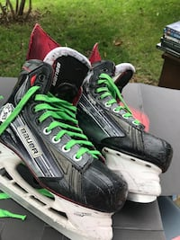 pair of black-and-green Bauer ice skates 42 mi